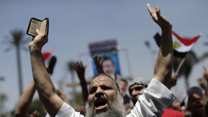 Supporters of ousted Egypt's President Mohammed Morsi chant slogans during a protest near the University of Cairo, Giza, Egypt, Friday, July 5, 2013. Egypt's Muslim Brotherhood called for a wave of protests Friday, furious over the military's ouster of its president and arrest of its revered leader and other top figures, raising fears of violence and retaliation from Islamic militants. (AP Photo/Hassan Ammar)
