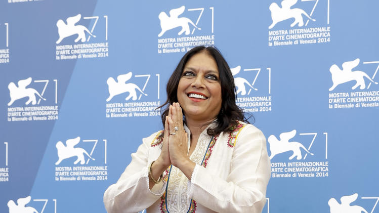 Director Mira Nair poses during the photo call for the movie 'Words with the gods' at the 71st edition of the Venice Film Festival in Venice, Italy, Saturday, Aug. 30, 2014. (AP Photo/Andrew Medichini)