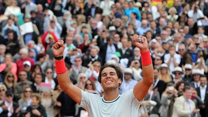 Spain's Rafael Nadal reacts after defeating France's Jo-Wilfried Tsonga during their semifinal match of the Monte Carlo Tennis Masters tournament in Monaco, Saturday, April 20, 2013. (AP Photo/Claude Paris)