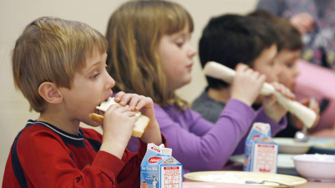 FILE- In this Feb. 3, 2010 file photo, students eat lunch at Sharon Elementary School in Sharon, Vt. Vermont ranks second in the country in an annual report of kids' well-being. The Annie E. Casey Foundation's Kids Count report released Monday shows improvements in eight areas like in the percentage of children with health insurance and fewer teen births but poverty continues to be a problem. Vermont fell slightly in the percentage of children with parents who lack secure employment to 29 percent. New Hampshire was the top-ranked state, followed by Vermont and Massachusetts. Nevada, Mississippi and New Mexico took the bottom three spots. Overall, Vermont ranked third in the country in education and family and community and fourth in health. (AP Photo/Toby Talbot)