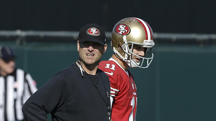 San Francisco 49ers head coach Jim Harbaugh, left, watches practice with quarterback Alex Smith (11) at an NFL football training facility in Santa Clara, Calif., Friday, Jan. 25, 2013. The 49ers are scheduled to play the Baltimore Ravens in the Super Bowl on Sunday, Feb. 3. (AP Photo/Jeff Chiu)