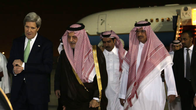 U.S. Secretary of State John Kerry, left, walks with Saudi Foreign Minister Prince Saud al-Faisal, on arrival in Riyadh, Saudi Arabia on Sunday, March 3, 2013. Saudi Arabia is the seventh leg of Kerry's first official overseas trip. (AP Photo/Jacquelyn Martin, Pool)