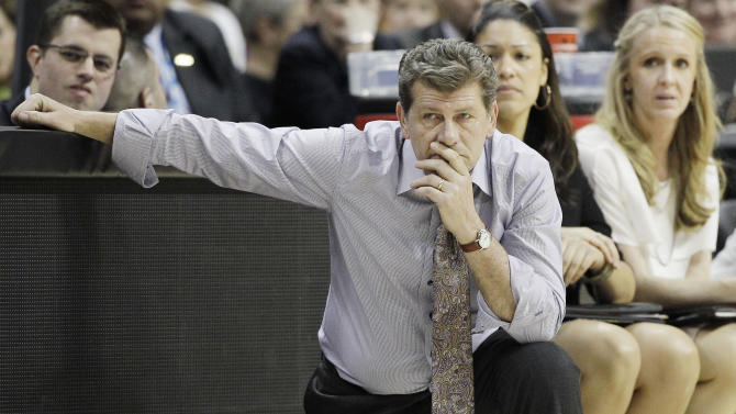 Connecticut head coach Geno Auriemma watches play during the second half of the NCAA women's Final Four semifinal college basketball game against Notre Dame, in Denver, Sunday, April 1, 2012. (AP Photo/Eric Gay)