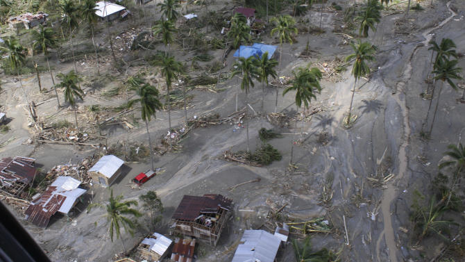 This photo released by the Philippine Army's 10th Infantry Division shows an aerial view of houses damaged by flash floods caused by Typhoon Bopha in Compostela Valley province, in the southern Philippines, on Thursday Dec. 6, 2012. The powerful typhoon that washed away emergency shelters, a military camp and possibly entire families in the southern Philippines has killed hundreds of people with nearly 400 missing, authorities said Thursday. (AP Photo/Philippine Army 10th Infantry Division) NO SALES