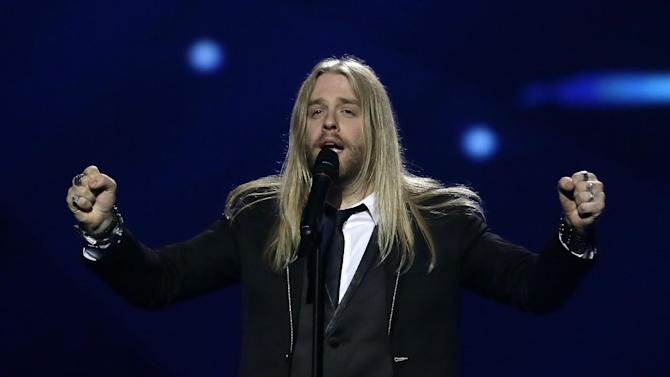 """Eythor Ingi of Iceland performs his song """"Eg A Lif"""" (I am Alive) during a rehearsal for the final of the Eurovision Song Contest at the Malmo Arena in Malmo, Sweden, Friday, May 17, 2013. The contest is run by European television broadcasters with the event being held in Sweden as they won the competition in 2012, the final will be held in Malmo on May 18. (AP Photo/Alastair Grant)"""