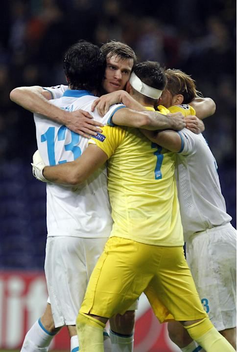 Zenit's Luis Neto, left, from Portugal, celebrates with teammates Nicolas Lombaerts, second left, from Belgium, goalkeeper Yuri Lodygin, and Cristian Ansaldi from Argentina, at the end of the Champion