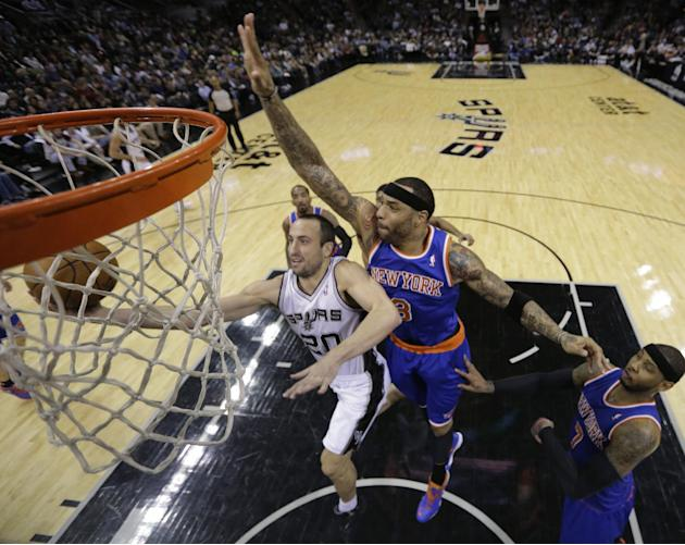 San Antonio Spurs' Manu Ginobili (20), of Argentina, is pressured by New York Knicks' Kenyon Martin (3) and Carmelo Anthony, right, as he tries to score during the second half on an NBA basket