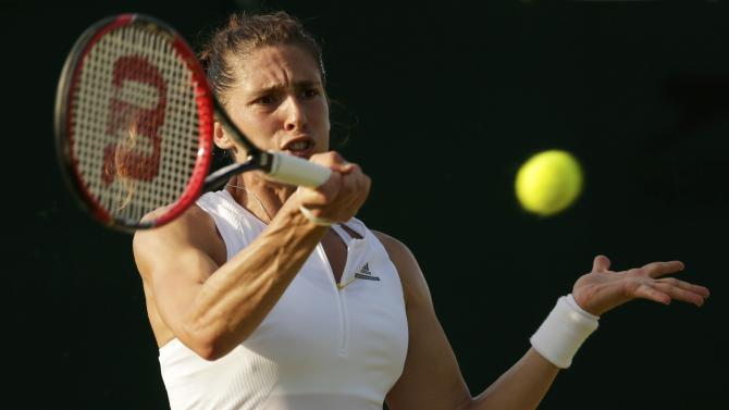 Andrea Petkovic of Germany hits the ball during her match against Mariana Duque-Marino at the Wimbledon Tennis Championships in London