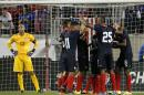 United States goalkeeper goalkeeper Tim Howard, left, looks on as Costa Rica players celebrate a goal by Joel Campbell during the second half of a international soccer friendly match, Tuesday, Oct. 13, 2015, in Harrison, N.J. (AP Photo/Julio Cortez)