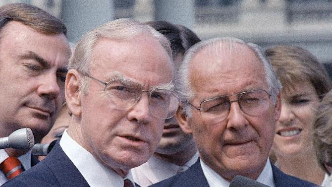 FILE - In this Aug. 5, 1987 file photo, then-House Speaker Jim Wright of Texas, left, and then-House Minority Leader Robert Michel of Ill. speak to reporters outside the White House in Washington. Wright, a veteran Texas congressman who was the first House speaker in history to driven out of office in midterm, has died. He was 92.  (AP Photo/Barry Thumma, File)