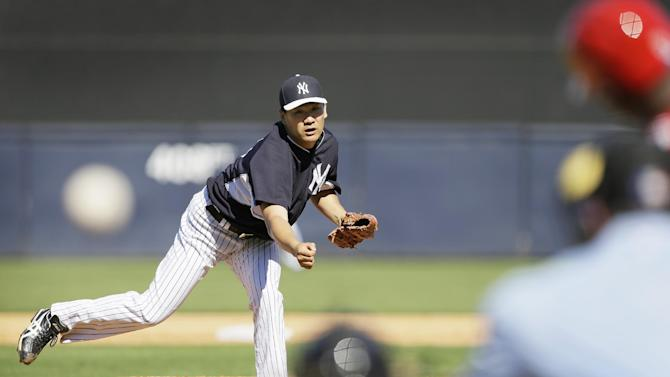 New York Yankees pitcher Masahiro Tanaka throws a pitch during the sixth inning of an exhibition baseball game against the Philadelphia Phillies Saturday, March 1, 2014, in Tampa, Fla