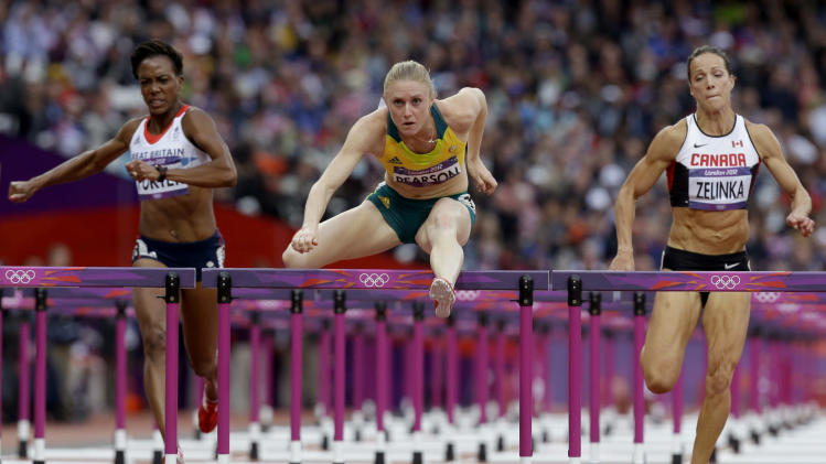 Australia's Sally Pearson, center, leads in a women's 100-meter hurdles semifinal during the athletics in the Olympic Stadium at the 2012 Summer Olympics, London, Tuesday, Aug. 7, 2012. (AP Photo/Anja Niedringhaus)