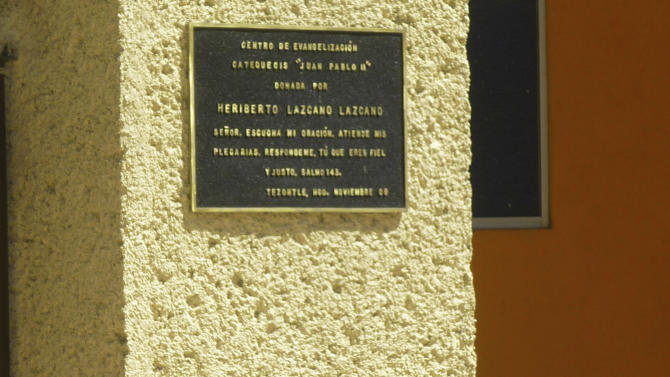 "FILE - This Oct. 20, 2010 file photo shows a plaque dated Nov. 2009 on the wall of a church in the neighborhood of Tezontle in Pachuca, Mexico. The plaque thanks the major donor who built the church, Heriberto Lazcano Lazcano, alleged leader of the Zetas, reading in Spanish ""Center for Evangelization and Catechism 'Juan Pablo II', donated by Heriberto Lazcano Lazcano, Lord, hear my prayer, listen to my plea. Answer me because you are faithful and righteous..Psalm 143.'  Mexico's Navy says fingerprints confirm that cartel leader Lazcano, an army special forces deserter, was killed Sunday, Oct. 7, 2012 in a firefight with marines in the northern state of Coahuila on the border with the Texas. (AP Photo/Victor Valera, File)"