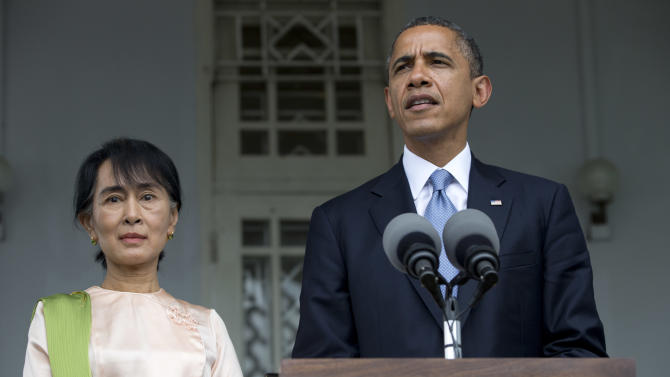 U.S. President Barack Obama and Myanmar opposition leader Aung San Suu Kyi speak to the press at her residence in Yangon, Myanmar, Monday, Nov. 19, 2012. Obama who touched down Monday morning, becoming the first U.S. president to visit the Asian nation also known as Burma, said his historic visit to Myanmar marks the next step in a new chapter between the two countries. (AP Photo/Carolyn Kaster)