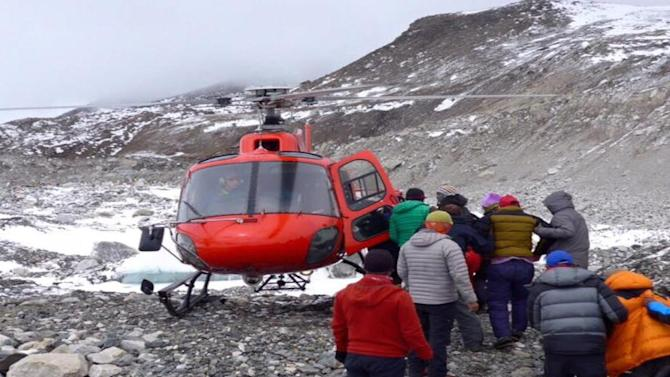 Singapore Team Awaits Rescue From Mount Everest