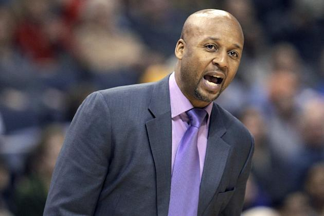 Denver Nuggets coach Brian Shaw shouts during the second half of an NBA basketball game against the Memphis Grizzlies in Memphis, Tenn., Saturday, Dec. 28, 2013. The Grizzlies defeated the Nuggets 120