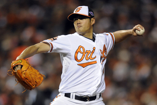 2 Baltimore Orioles starting pitcher Wei-Yin Chen, of Taiwan, throws to the New York Yankees in the second inning of Game 2 of the American League division baseball series on Monday, Oct. 8, 2012, in 