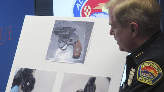 Albuquerque Police Chief Gorden Eden discusses a gun found on a man shot by police during a news conference, Wednesday, March 26, 2014, at Albuquerque Police headquarters in Albuquerque, N.M. The Albuquerque Police Department came under new scrutiny after officers shot and killed Alfred Redwine, 30, outside a public housing complex in the second deadly encounter in the last 10 days. Eden said Redwine fired at officers and police returned fire. However, Redwine's family said that Redwine was not armed and only had a cellphone in his hand. (AP Photo/Russell Contreras)
