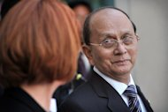 Myanmar President Thein Sein and Australian Prime Minister Julia Gillard at Parliament House in Canberra on March 18, 2013. Thein Sein&#39;s trip is the latest example of his new-found globetrotting diplomacy that has seen him address the UN General Assembly, meet a host of European Union leaders and be feted at a number of international summits