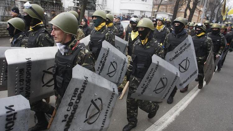 "Anti-government protestors of the ""14 Hundred Self-Defense"" group take part in a protest rally in front of the Prosecutor General building in Kiev on February 14, 2014"