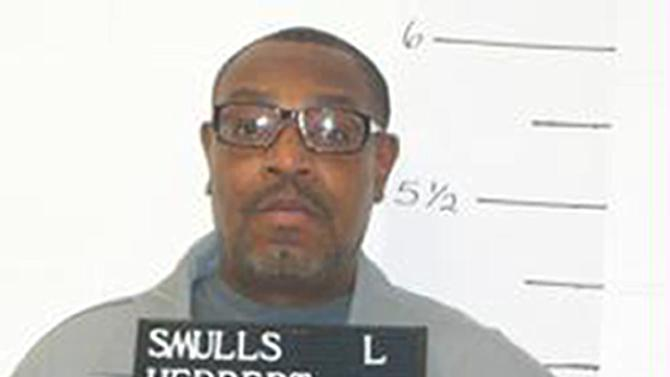 FILE - In this Dec. 13, 2011 file photo released by the Missouri Department of Corrections is death-row inmate Herbert Smulls who is scheduled to die by injection one minute after midnight Wednesday, Jan. 29, 2014 for killing St. Louis County jeweler Stephen Honickman in 1991. The U.S. Supreme Court has granted a stay of execution for Missouri death row inmate Herbert Smulls, Tuesday, Jan. 28, 2014. Justice Samuel Alito signed the order that was sent out Tuesday night after President Barack Obama's State of the Union speech. (AP Photo/Missouri Department of Corrections)