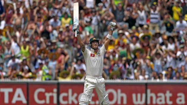 Australia's captain Michael Clarke celebrates reaching his century during the second day of the second cricket test against Sri Lanka at the Melbourne Cricket Ground