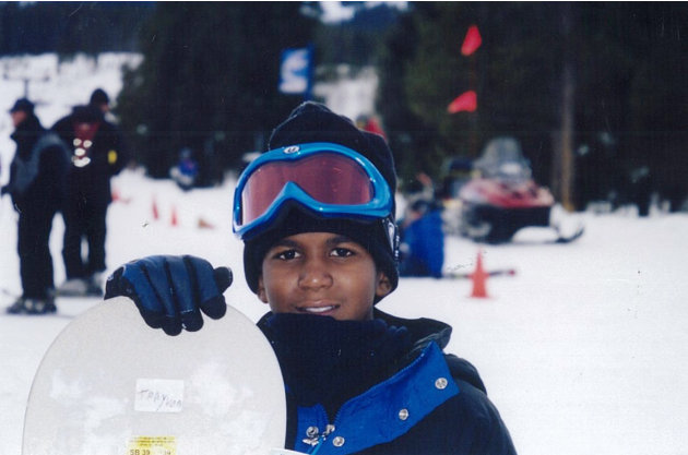 This undated file photo provided by the Martin family, shows Trayvon Martin snowboarding. Martin was slain in the town of Sanford, Fla., on Feb. 26 in a shooting that has set off a nationwide furor ov