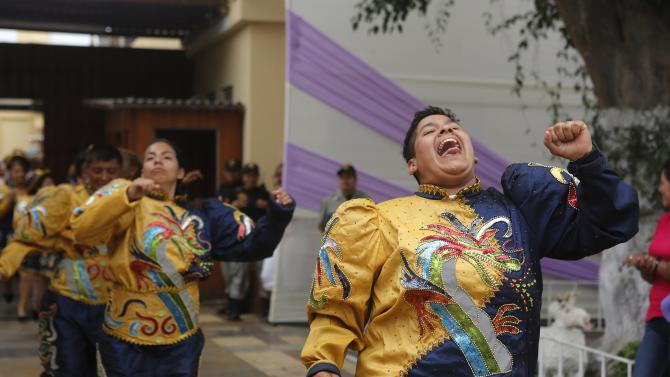 Inmates dance at an event ahead of the International Women's Day at the Santa Monica female prison in Lima