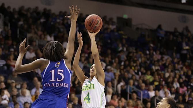 Notre Dame guard Skylar Diggins (4) takes a shot over Kansas forward Chelsea Gardner (15) as guard Angel Goodrich (3) watches during the second half of a regional semi-final of an NCAA college basketball tournament Sunday March 31, 2013 in Norfolk, Va. Notre Dame won 93-63.  (AP Photo/Steve Helber)