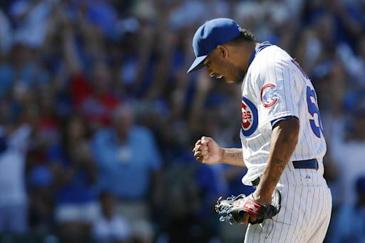 Lester strikes out 14 to lead Cubs over Rockies 3-2