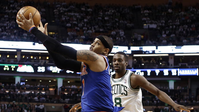 New York Knicks' Carmelo Anthony grabs a pass over Boston Celtics' Jeff Green (8) during the second quarter of Game 3 of a first round NBA basketball playoff series, Friday, April 26, 2013, in Boston. (AP Photo/Winslow Townson)
