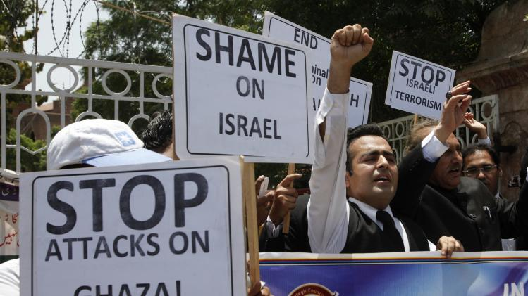 Lawyers hold placards as they chant slogans during a protest against Israel's air strikes in Gaza, in Lahore