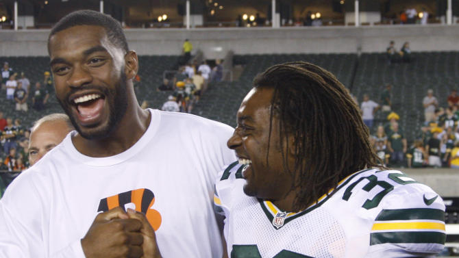 Cincinnati Bengals tight end Jermaine Gresham meets with Green Bay Packers running back Cedric Benson (32) after the Packers beat the Bengals 27-13 in an NFL preseason football game, Thursday, Aug. 23, 2012, in Cincinnati. (AP Photo/David Kohl)