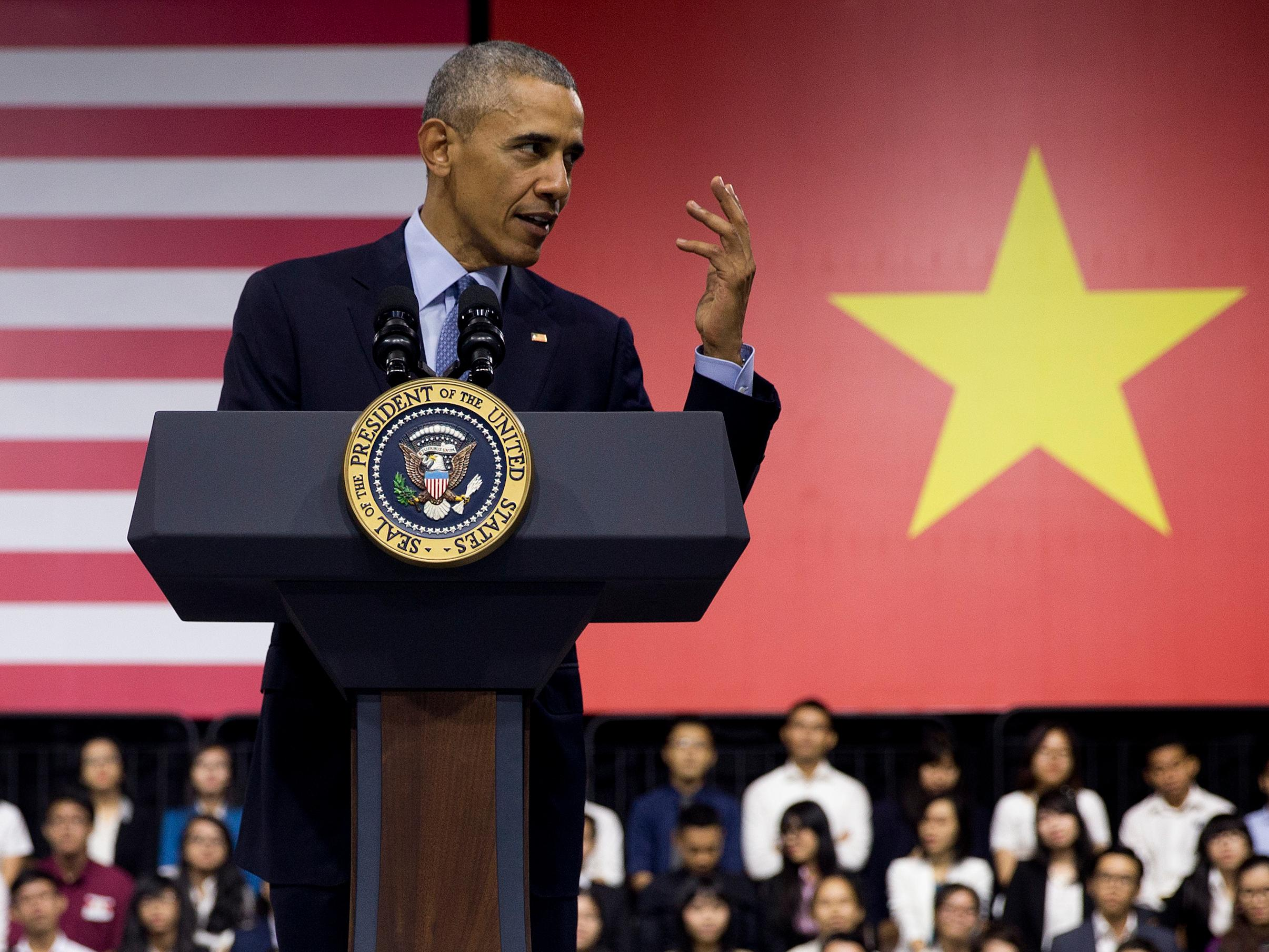 Obama defended a cornerstone of his legacy in Asia as it keeps getting shredded at home