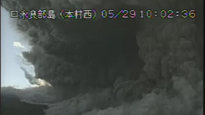 In this image taken from a surveillance camera observed from Motomura Nishi on Kuchinoerabu island, a column of black smoke rises from Mount Shindake, on the island, southern Japan, Friday, May 29, 2015. The volcano erupted on the small island about 10 a.m. local time Friday, spewing black clouds of ash and rock towering into the sky and prompting authorities to tell residents to evacuate the island. (Japan Meteorological Agency via AP) CREDIT MANDATORY