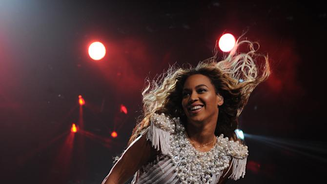 """IMAGE DISTRIBUTED FOR PARKWOOD ENTERTAINMENT - Singer Beyonce performs on her """"Mrs. Carter Show World Tour 2013"""", during the BET Experience music festival on Friday June 28, 2013, in Los Angeles. Beyonce is wearing a custom hand beaded peplum one-piece by Ralph & Russo with shoes by Stuart Wieztman. (Photo by Frank Micelotta/Invision for Parkwood Entertainment/AP Images)"""