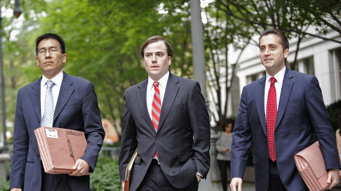 Assistant U.S. Attorneys, from left, Edward Kim, Sean Buckley and John Cronan leave Manhattan federal court in New York on Saturday, Oct. 6, 2012. Five terrorism suspects appeared in New York and Connecticut federal courts Saturday, hours after they lost years long extradition fights in Britain and were transported to the U.S. under tight security to face trial. (AP Photo/ Louis Lanzano) A reporter does a live broadcast outside Manhattan federal court, Saturday, Oct. 6, 2012, in New York. Manhattan US attorney announced extraditions of three alleged international terrorists from Great Britain including Abu Hamza al- Masri who will appear in court today. (AP Photo/ Louis Lanzano)