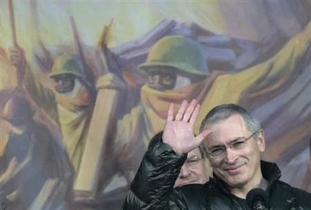 Former oligarch Khodorkovsky waves to Ukrainians during an anti-war rally at Independence Square in Kiev