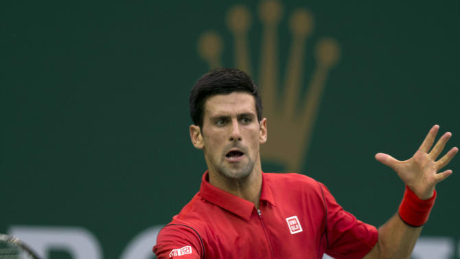 Serbia's Novak Djokovic returns a shot to Spain's Marcel Granollers at the Shanghai Masters tennis tournament at the Qizhong Forest Sports City Tennis Center in Shanghai, China, Wednesday, Oct. 9, 2013. Djokovic won 6-2, 6-0. (AP Photo/Ng Han Guan)