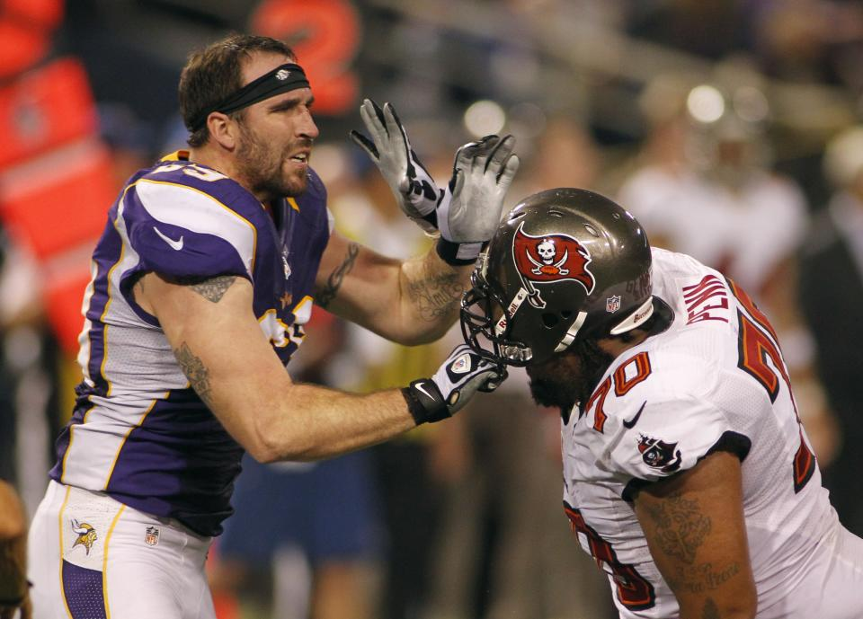 Minnesota Vikings defensive end Jared Allen, left, gets in a tussle with Tampa Bay Buccaneers tackle Donald Penn, right, during the second half of an NFL football game Thursday, Oct. 25, 2012, in Minneapolis. (AP Photo/Andy King)