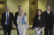 Amy Thompson, second from right, defense attorney for William Balfour, and her team return from hearing a question from the jury during deliberations at Cook County Criminal Court, Friday, May 11, 2012, in Chicago. Balfour, is charged in the 2008 murder of Oscar and Grammy winning performer Jennifer Hudson&#39;s mother, brother and nephew. (AP Photo/M. Spencer Green)