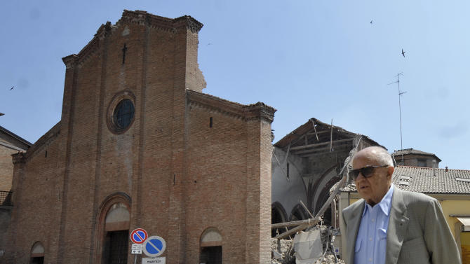 A man walks in front of a collapsed church in Mirandola, northern Italy, Tuesday, May 29, 2012. A magnitude 5.8 earthquake struck the same area of northern Italy stricken by another fatal tremor on May 20. (AP Photo/Marco Vasini)