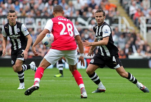 Newcastle United's French midfielder Yohan Cabaye (R) vies with Arsenal's English midfielder Kieran Gibbs (2nd R) during the English Premier League football match between Newcastle United and Arsenal at St James' Park in Newcastle, north-east England on August 13, 2011. AFP PHOTO/IAIN BUIST