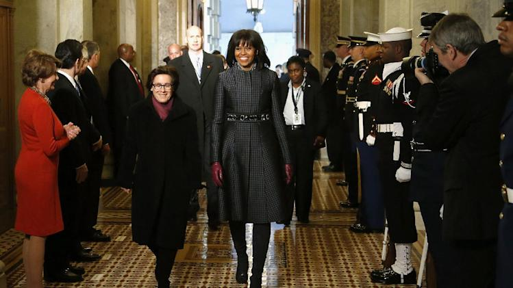 First lady Michelle Obama arrives on Capitol Hill in Washington, Monday, Jan. 21, 2013, for President Barack Obama's ceremonial swearing-in ceremony during the 57th Presidential Inauguration.  (AP Photo/Jonathan Ernst, Pool)