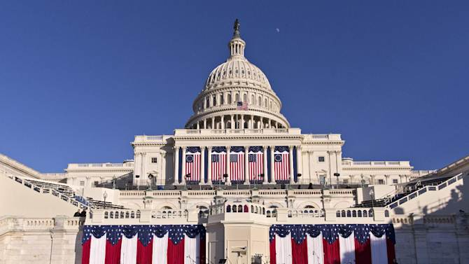 The West Front of the U.S. Capitol is dressed in red, white and blue the day before President Obama's public inauguration ceremony, in Washington, Sunday, Jan. 20, 2013. President Obama took the official oath of office at the White House at noon Jan. 20, as mandated by the Constitution. (AP Photo/J. Scott Applewhite)