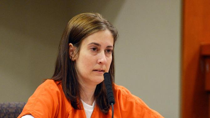 FILE- In this Aug. 20, 2013 file photo, Andrea Sneiderman gives a statement during her sentencing hearing in Decatur, Ga. Georgia officials say Sneiderman, who was convicted of lying during the investigation of her husband's killing outside an Atlanta-area preschool, was released from prison Monday, June 16, 2014. (AP Photo/Atlanta Journal-Constitution, Kent D. Johnson, File) MARIETTA DAILY OUT; GWINNETT DAILY POST OUT; LOCAL TV OUT; WXIA-TV OUT; WGCL-TV OUT