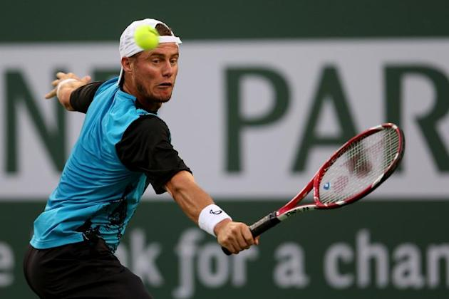 Lleyton Hewitt of Australia hits a return to compatriot Matthew Ebden during the BNP Paribas Open, at Indian Wells Tennis Garden in California, on March 6, 2014