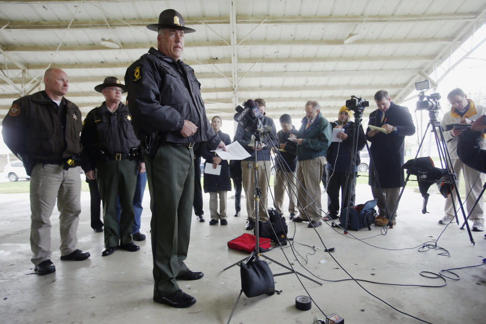 Illinois State Police Lt. Col. Todd Kilby addresses the media gathered in Manchester, Ill., after five people were found slain at a house early Wednesday, April 24, 2013. Authorities said the suspect died after a car chase and an exchange of gunfire with law enforcement. (AP Photo/The State Journal-Register, Ted Schurter)