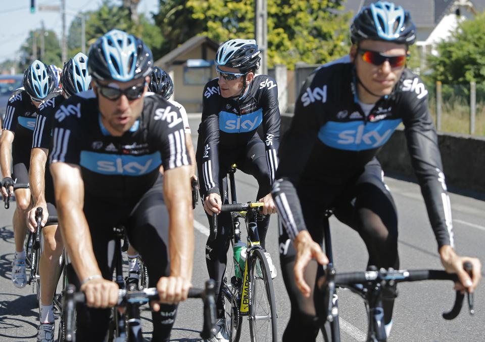 Bradley Wiggins of Britain, second right, rides with his teammates during a training on the rest day of the Tour de France cycling race in Pau, France, Tuesday July 17, 2012. (AP Photo/Laurent Cipriani)