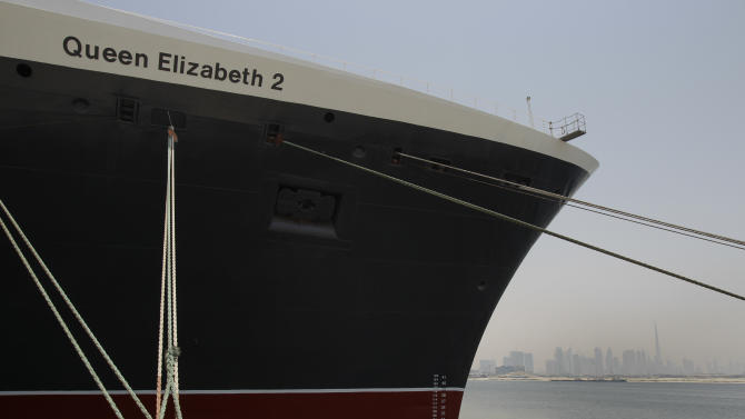 The Queen Elizabeth 2 is seen at dock as Istithmar World, the Dubai state investment company that owns the ship, outlined plans Monday to turn the retired cruise liner into a 300-room hotel, ending years of speculation about its fate, in Port Rashid, Dubai, United Arab Emirates, Monday, July 2, 2012. Britain's Queen Elizabeth II launched the QE2 in 1967. (AP Photo/Kamran Jebreili)